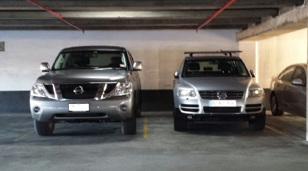 Nissan Patrol Ti-L- In a car park next to a Volkswagen Touareg
