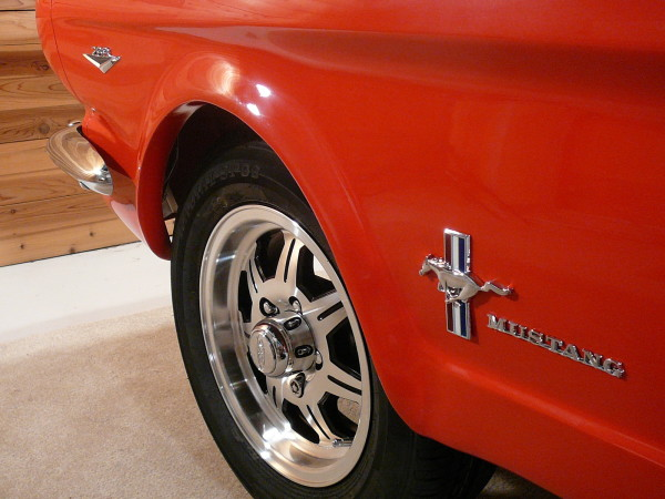 The Ford Mustang pool table features genuine 1965 Mustang badges.