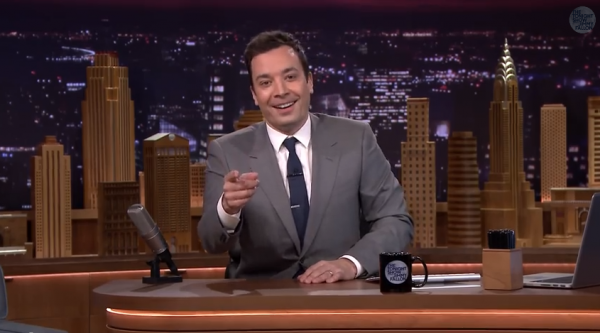 Jimmy Fallon at the desk of the Tonight Show
